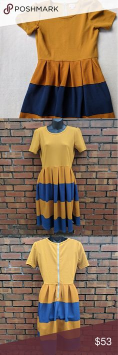 LuLaRoe Amelia Golden Yellow & Blue Pleated Dress Pre-owned but in good condition. No flaws, minimal wear. Please see pictures above for measurements.   Offers are always welcome.   30% off bundles of 2+ items.   E&T LuLaRoe Dresses