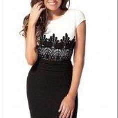 White and black color block dress with lace Beautiful color block dress with lace. Great piece for office or night. Comfy material. Dresses
