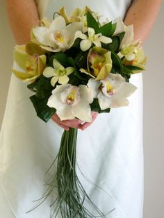 Orchid Wedding   Cymbidium and dendrobium orchids with rhapsis leaves and beargrass.