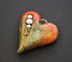 Rustic Polymer Clay Heart With Pearls.  Actually makes me interested in exploring polymer clay...