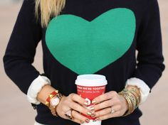 vintage pretty: Sweaters Sweaters everywhere! - love the heart and the bracelets and the rolled up sleeves and her fingernails =)