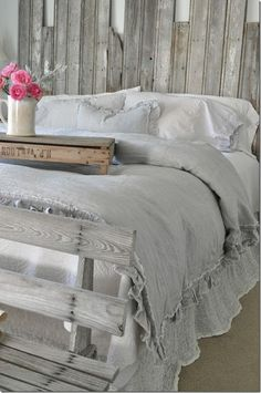 Bedroom inspiration, farmhouse bedroom, DIY headboard, rustic headboard, reclaimed wood, bedding, French farmhouse, Pom Pom at Home, ruffles, grey bedroom, white bedding, elegant farmhouse, farmhouse style, fresh flowers, Becky Cunningham home, Buckets of Burlap