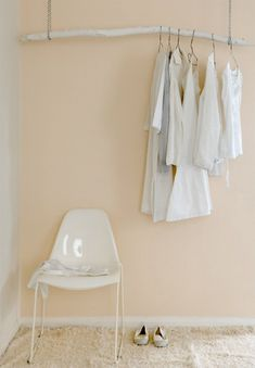 Great #DIY idea - a hanging branch as an artful way to hang clothes but could also hang pictures by using ribbon to hold them on to the branch