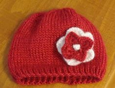 Stockinette Flower Baby Beanie.  Free pattern with a good tutorial to make the knitted flower.