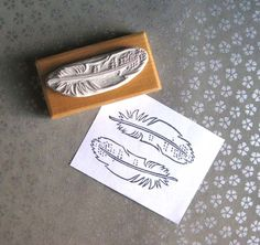 Hand-carved feather stamp by Extase