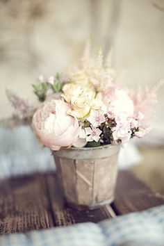 I love this rustic look w/ pretty flowers concept--sort of a mix of farm-chic and girlie
