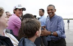 The President has a smile on his face as he greets well wishers at the Cape Cod Coast Guard Air Station on his journey home
