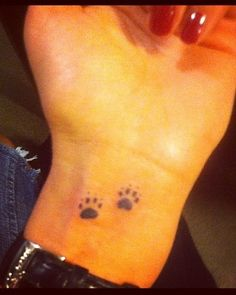 I really want a paw print tattoo - I love animals and my fur babies :)