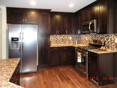 kitchen-color-schemes-with-dark-cabinets-mosaic-tile-kitchen-backsplash-pictures-laminate-wood-floor-kitchen-island-granite-countertops-with-stove-top- ...