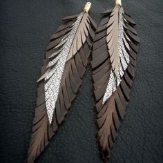 Leather Feather Earrings - Brown, gold and silver shoulder dusters. $42.00, via Etsy.