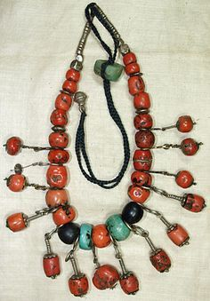 Old Berber necklace estimated to be over 800 years ago; red coral, coin silver, brass and amazonite.