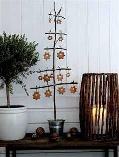 Cookie Christmas tree. Make your own handmade quirky tree with found tree limbs. Add ginger cookies tied on with ribbon.