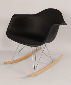 Modernism is at play in this timeless chair, created in the style of iconic duo Charles and Ray Eames: pioneers of postwar design. It breathes life into any space and broadcasts an eye for trendy aesthetics.24.5'' W x 26.63'' H x 27 D''Weight capacity: 200 lbs.Body: polypropyleneBase: steelSleighs: ash woodImported