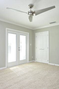 neutral shimmery gray walls with clean white trim, double french doors, stainless steel three blade modern style fan, neutral Berber carpet. by the BEST custom construction contractor Neutral Carpet, Neutral Walls, White Carpet, Carpet Colors, Bedroom Neutral, Neutral Paint, Green Carpet, Trendy Bedroom, Modern Bedroom
