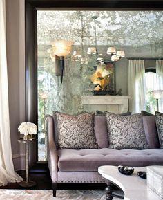 antiqued 'wall' mirror velvet sofa - instant luxurious depth - kardashian jenner home - california - jeff andrews
