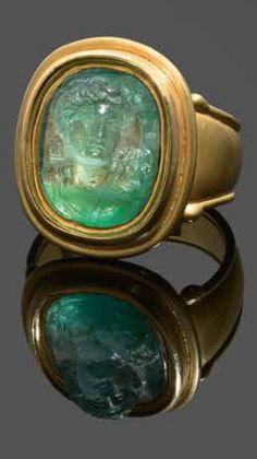 A gold and emerald cameo ring. Emerald cameos are extremely rare due to the gem being the most difficult to carve for its internal structure. The Castellani House produced remarkable cameos in sapphires and emeralds. This cameo, in perfect condition, was made by a very sure hand as can be seen in the fine details of Diane's face, the movement of her hair and the draping of her costume.