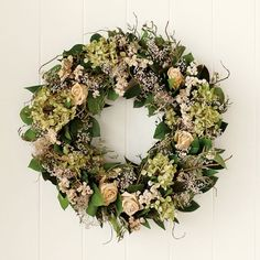 White Rose Wreath  at Williams Sonoma. What a beautiful wreath that I might just have to have.