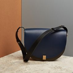 """173 Likes, 6 Comments - STYLEBOP.com (@stylebop) on Instagram: """"This tonal half-moon shoulder bag by Victoria Victoria Beckham is the perfect size for your every…"""""""