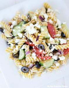 A recipe for Greek pasta salad tossed with an herb vinaigrette. This healthy pasta salad can be eaten warm or cold.
