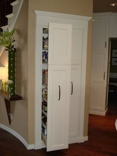 Pull out storage under stairs. Would make a great pantry.  Yet another way to use the under stair space.