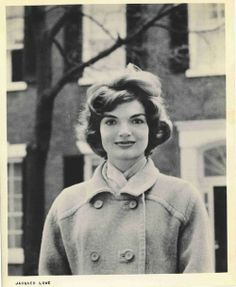 hair, coat and smiling with her eyes. 1959