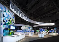 This eye-cathching, rental exhibit won the Best of MOD Award and features dimensional curves and corporate colors inspired from VMware's website and materials.  MG Design: Trade Show Exhibits, Events, Environments, Experiences.   http://www.mgdesign.com