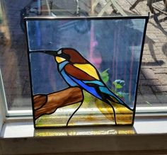 Beeeater suncatcher in Stained glass, glass hanger of bird, beeeater, Tiffany, window hanger, sun catcher, window art with different colors size 25 cm wide I make all different types of these hangers, please contact me for your special choice of bird.   If you order a different color, or the color of the picture, glass may vary from the original shown, even when same colors are used. Each sheet of glass is unique, and that's exactly how we love it, right?!  I strive to make unique pieces…