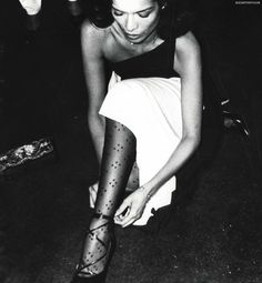 Bianca Jagger fixes her shoe strap at Studio 54, late '70s