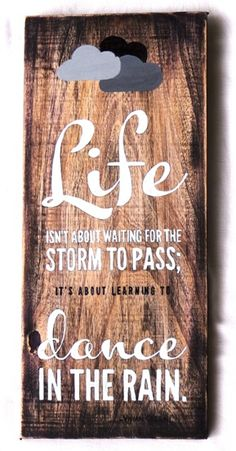 life isn't about waiting for the storm to pass...hand painted quote on wood