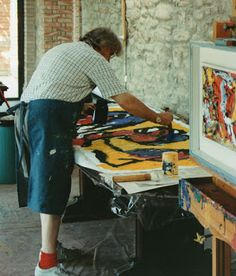 Karel Appel in his atelier. (25 April 1921 – 3 May 2006) was a Dutch painter, sculptor, and poet. He started painting at the age of fourteen and studied at the Rijksakademie in Amsterdam in the 1940s. He was one of the founders of the avant-garde movement Cobra in 1948.