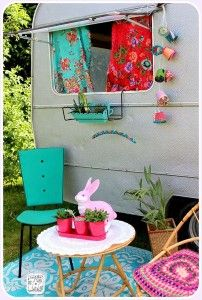 Vintage camper. Like the two color window curtains.