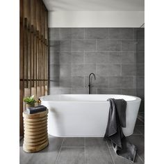 Nothing says relaxation like a floor mounted bath mixer! Featured is the Vivid Slimline Floor Mounted Mixer in ONIX matte black. Thanks to Arden Homes for the image.