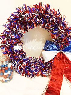 Easy to make, red, white and blue Fourth of July Patriotic Wreath Decoration. A simple decoration to make for a backyard barbeque or other holiday celebration.