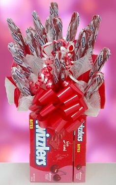 This is so much better than flowers ...Twizzler Edible Candy Base from All About Gifts and Baskets