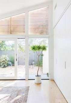 Image result for small high windows in bedroom mid century modern blinds shutters