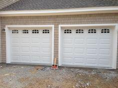 Haas model 680 Steel Raised Panel Garage Doors in White with Cascade Glass. Installed by Mortland Overhead Door. mortlanddoor.com
