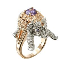 Elegant and exotic, bold yet versatile. This blinged-out ring is made from rose gold-plated brass and features one seriously marvelous mammal. Encrusted in cubic zirconia, from hoof to tusk—step into any room—this pink(ish) elephant won't be ignored. Master of costume jewelry and sorcerer of the bedazzled jungle, designer Kenneth Jay Lane does it again.
