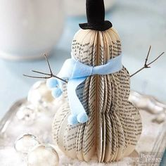 What You Have: an old book, felt, twigs To transform an old book into a snowman, remove the cover, trim the pages to form a snowman shape, and glue the ends together. Fan out the pages, and accessorize Frosty with felt and twigs./