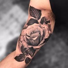 A lush rose by Joey Boon #joeyboontattooartist #joeyboon #realism #realistic #hyperrealism #blackandgrey #rose #leaves #tattoooftheday