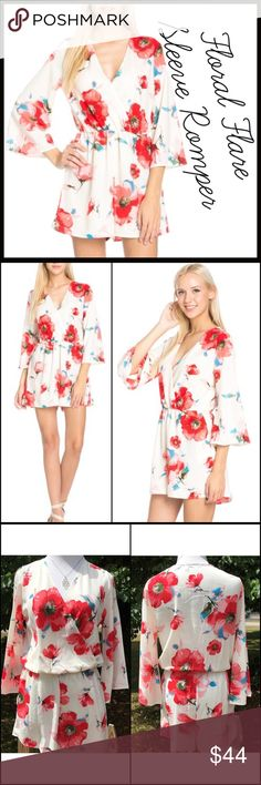 Vibrant Floral Romper Vibrant poppy floral pattern on a lined chiffon romper. It has a cinched waist and crossover v-front neckline. Great for a more conservative and sophisticated look, yet still a trendy romper. Gorgeous! RETAIL ITEM- PRICE IS FIRM UNLESS BUNDLED. Boutique Pants Jumpsuits & Rompers