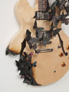 """Paul Villinski - """"Rise"""" - electric guitar, aluminum (found beer cans), wire, soot. 2007"""
