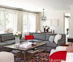 Gray couch, red and white accents