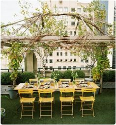 Fabulous outdoor dinner party with lovely yellow chairs