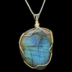 We accept bespoke orders for similar style pendants. Sold: Large Labradorite Cabochon Wire Wrapped in Sterling Silver Wire.
