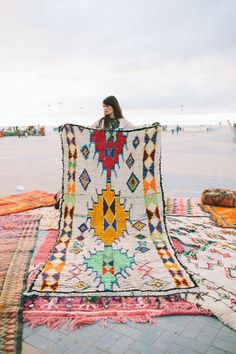 I'm never not in the market for a new, old rug. So you can see how after stumbling upon interior designer Veronica Hamlet's collection of vintage Moroccan rugs, pillows and baskets, I know I'm in trouble. The vibrant colors and distinctive patterns . . . be still my heart and be kind to my