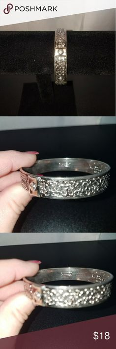 Coach Bangle Bracelet This is a reposh.  Sadly it didnt fit my big hands.  It is a beautiful bracelet in excellent condition. Coach Jewelry Bracelets