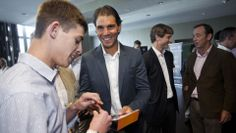 Rafael Nadal interacts with one of his many admirers from Sabadell Bank at the VIP Party Sony Open, Miami 2014