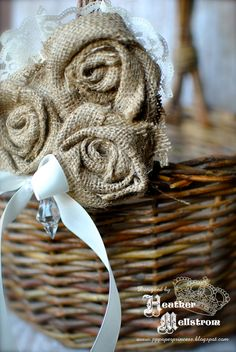 Burlap and lace flower accent- perfect addition to wedding decor and flower girl baskets. $18.00, via Etsy.