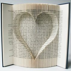 Book Folding Pattern with cuts Inverted Heart: + Free printable . Folded Book Art, Paper Book, Pattern Cutting, Pattern Art, Book Crafts, Paper Crafts, Book Folding Patterns Free, Sell Your Books, Book Sculpture