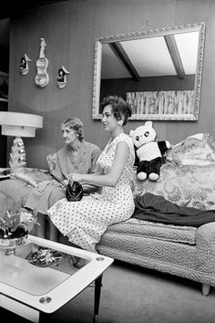 Barbara Hearn Elvis's high school sweetheart and his grandmother, Minnie Mae listen to some of the songs that Elvis recorded two days earlier.In the living room of the family home at 1034Audubon Drive. Memphis, TN, July 4, 1956.
